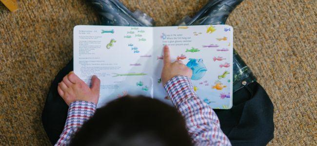 Photo of a boy reading book 1250722